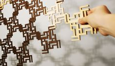 IScreen is a laser-cut, modular unit screen of an interlocking shape derived from the letters L I S A. The pieces are cut from plywood and masonite and allow for multiple arrangements and custom sizes.