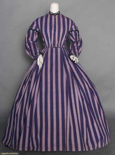 "PURPLE STRIPE DAY DRESS, 1860s 1-piece, light weight wool woven in alternating dark & light purple stripes w/ orange pin stripes, jet F buttons & trims, cap sleeve w/ jet tassels, brown cotton bodice lining, B 35"", W 27.5"", L 54""-59"""