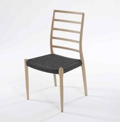 Model No 82 Chair Designer: Niels Otto Moller Manufactured by: J.L. Moller Dimensions (in): 19.7 w | 20 d | 37 h | seat: 19.7 w | 17 d | 17.3 h Chair also avail