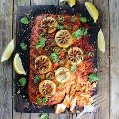 Cedar Plank Harissa Smoked Salmon marinated w/garlic, honey, lemon, harissa, & paprika, served with Moroccan couscous. Tender, flaky, & full of flavor!   #salmon http://tasteandsee.com
