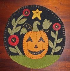 Jack-O-Lantern penny rug