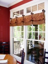 Kitchen window treatments! Do not do this! It will look so much better if you move it up to the top set of windows trust me.