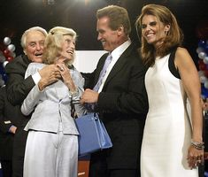 October 7, 2003 -the newly-elected Governor of California Arnold Schwarzenegger, accompanied by Maria, greets his in-laws, Sargent Shriver and Eunice Kennedy, after delivering a victory speech at a party in Los Angeles