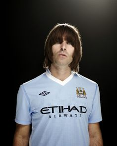Liam Gallagher from Oasis wearing a Manchester City shirt