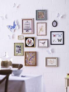 Cuadros y mariposas de papel