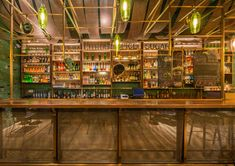 This Shanghai bar featuring bamboo-lined walls by local architects Neri&Hu specialises in one drink – punch – after which it is named. Cafe Bar, Shanghai, Neri And Hu, Bar Design Awards, Circular Mirror, Reclaimed Timber, House Inside, Design Firms, Retail Design