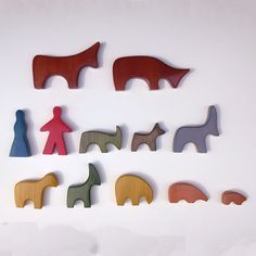 Multicolored wooden farm set, with both animals and farmer and wife figures, from range of brightly colored toys representing various mammals, Switzerland, 1950, by Antonio Vitali, imported exclusively into the United States by Creative Playthings.
