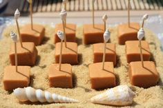 Seaside holiday party - fudge with shell toppers on sugar 'sand'