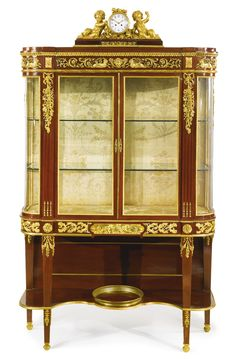 A LARGE AND FINE LOUIS XVI STYLE GILT BRONZE MOUNTED MAHOGANY VITRINE ON STAND France, early 20th century