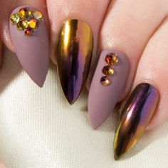 This smouldering chrome nail design is sure to put a swagger in your step, and a sinful smile on your lips. Featuring a decadent purple and copper ombré and an elegant mauve matte embellished with glittering Swarovski® crystals, these false nails are just waiting to wrap you in glamour. Coated with two layers of gel top coat for extra durability and a soft-touch matte finish, they are provided with all the accessories youll need for a flawless application. They also come in a choice of nine…