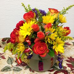 Birthday flowers in a vase with candles in it from Ambrosia Floral.