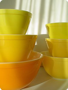 Yellow and orange pyrex mixing bowls
