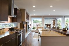 This sleek, contemporary kitchen opens to an outdoor patio with fireplace. The Verada Q1 plan, built by MainVue Homes, at Parkhaven. Bothell, WA