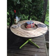 Upcycled indoor/outdoor swivel coffee table made from cable drum, reclaimed hardwood fence pailings and retro chair base. More furniture available @ www.facebook.com/groups/VintageReclaimed