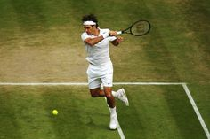 Roger Federer of Switzerland during his Gentlemen's Singles quarter-final match against Stan Wawrinka of Switzerland on day nine of the Wimbledon Lawn Tennis Championships at the All England Lawn Tennis and Croquet Club  at Wimbledon on July 2, 2014 in London, England.