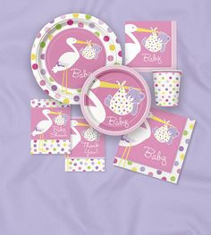 Baby Girl Stork Collection  Theme Collection includes: Dessert plates-Diner plates-Tablecloth-Luncheon napkins-Beverage napkins-Paper cups (9oz)-Invitations-Centerpiece-Danglers-Jointed banner-Cupcake kit