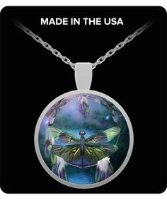 Spirit Of The Dragonfly round pendant necklace featuring the art of Carol Cavalaris.