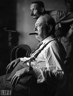 "Warrior  Churchill looks at enemy positions from a fortified forward position in Italy in 1944. ""It took me a little while to get used to the fact that in two days his cigar consumption was the equivalent of my weekly salary,"" his valet Roy Howells wrote later."