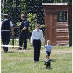 Prince George walking w Nanny Maria (and Lupo) to wave good-bye to Uncle Harry.  6/12/2015