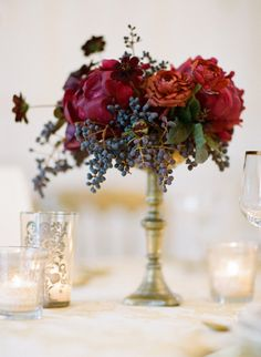 Magnificent red floral centerpiece in footed vase. #red #centerpiece #tall