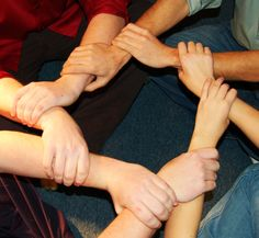 interlocking hands -- how the body of Christ can and should work together.