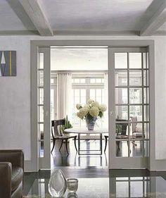 Add pocket doors to dining room to still let light through from new windows.