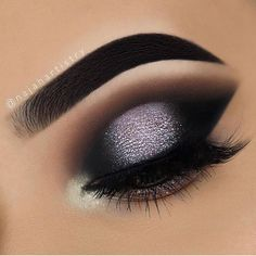 Dramatic modern smokey eye. Black dark eye shadow with silver glitter flakes, live this super dramatic eye makeup. Perfect for a night out or vampy look.