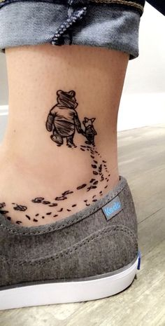 I love the concept of friendship on this ankle tattoo - Winnie The Pooh and Piglet