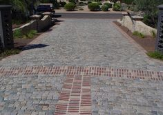 """Antique sandstone 3"""" to 4"""" and antique brick banding, Scottsdale AZ. Authentic reclaimed antique granite or sandstone cobblestone, excellent for driveways or walkways, available in multiple sizes. Imported from Europe, by Monarch Stone International, nationwide. Cobblestone, pavers, old, used cobblestone paving stone, driveways, walkways, Belgian Block.."""