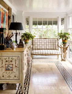 An antique gilded settee sits in a sunny window bay. - Photo: Emily Jenkins Followill