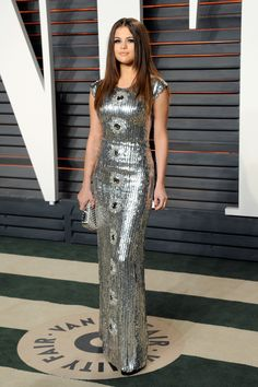 Inside the Most Exclusive Oscar After-Parties Selena Gomez in Louis Vuitton, Jimmy Choo shoes with Tod's bag
