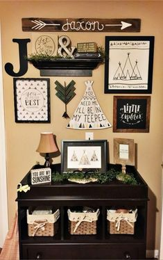 This rustic nursery accent wall is ADORABLE!  Love the dresser with the baskets and all the rustic nicknacks on the wall above it!