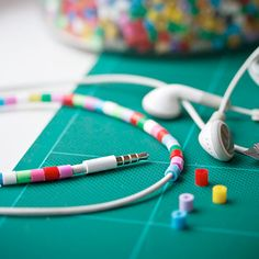 Perler bead pimped earphones. (in Swedish and English). Just cut on side to get around headset in the colors of your choice. Good to claim my headset in our house.