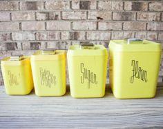 SALE // Mid century 1950s yellow plastic bakelite typographic kitchen canister set flour sugar coffee tea containers