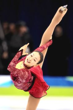 Mao Asada presenting excellent artistry, balletic fingers, and extension.