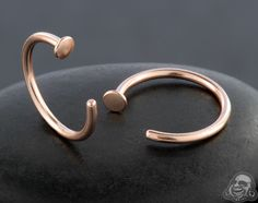 Rose gold colored nose hoop