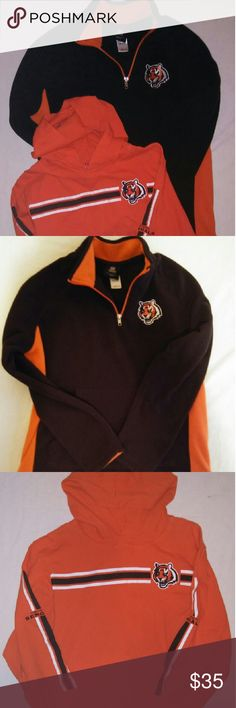 Two Youth Cincinnati Bengals Long Sleeve Shirts Lot of 2 Cincinnati Bengals Youth Shirts.?  Cincinnati Bengals youth long sleeve hooded shirt size med. 100% cotton Orange in color has kangaroo pocket in front, logo on chest with stripes across chest and stripes down each sleeve and says Cincinnati Bengals. Excellent Condition .?  Cincinnati Bengals youth half zip pull over sweatshirt size large. 100% polyester, black in color with Bengal logo on chest, k NFL Apparel   Shirts & Tops Tees…