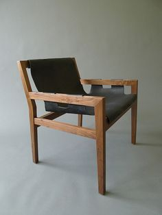 With a nod to the furniture designs of the mid-century modern era, the Sling chair has all the hallmarks of a future classic. The Sling chair's simple design features beautifully executed joinery details in handsome oiled walnut and a comfortable black leather sling seat.   KWH Furniture Design and Fabrication