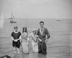 Bashful bathers take to the waters at Southend-on-Sea, Essex. (Photo by Topical Press Agency/Getty Images). August 1919