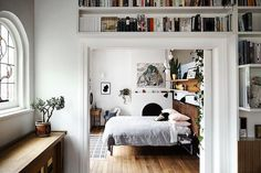 Open-space apartment with wooden floors and lots of white.