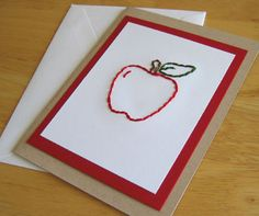 Apple Cards. An apple stitched right onto the paper front of the card. Set on a bright red card stock, then a homey brown card.
