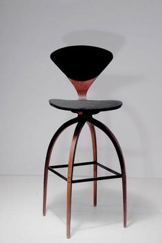 Norman Cherner; Walnut Veneer and Painted Iron Bar Stool for Plycraft, 1957.
