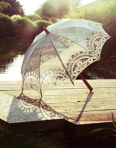 A delicate lace parasol makes the perfect accessory for a summer wedding <3 B