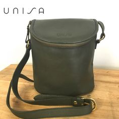 """Unisa Vintage genuine leather bag Such adorable bag!!! Very good condition and 100% Authentic Unisa Vintage genuine leather crossbody bag, beautiful olive green color. No Tear, stain in inside or in the outside. Dimensions are 9"""" X 7.5"""" X 4"""" Strap drops 23"""" long. Comes from smoke free home. Unisa Bags Crossbody Bags"""
