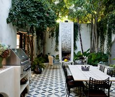 This is our courtyard with outdoor dining and living room.  The floor is custom mexican cement tile designed by Commune.  Fireplace by Stan Bitters.  Landscaping by Matthew Brown. completely need this tiled courtyard with HIGH walls, fountain at one end and lots of greenery how divine