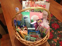 New/nursing mom gift basket - magazines, snacks, gum/mints, hand sanitizer & wipes, hand cream, lip balm, rubber bands, water, iTunes card and snacks/toys for older sibling!