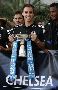 Chelsea defender John Terry holds the Barclays Asia Trophy after arriving in Hong Kong