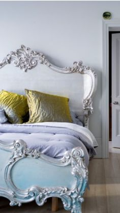 Exuberantly rocaille French bed, sculpted and painted wood.