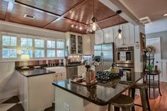 Country Kitchen with Flush, Breakfast bar, High ceiling, Farmhouse sink, Kitchen island, Carpet, L-shaped, Glass panel
