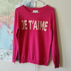 Elle Je t'aime sweater In great condition, very soft! No snags or pulls. No pilling either. The letters stick off the sweater made out of a different material. Bottom of sweater have a lighter shade of pink trimming! Just too cute! Elle Sweaters Crew & Scoop Necks